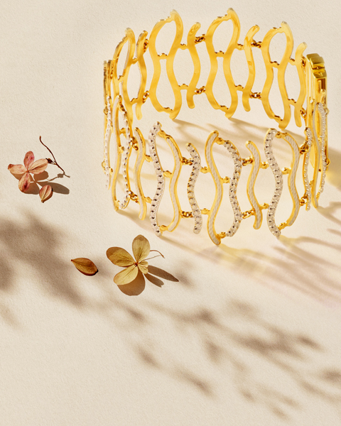 22k two-tone gold swirls statement bracelet