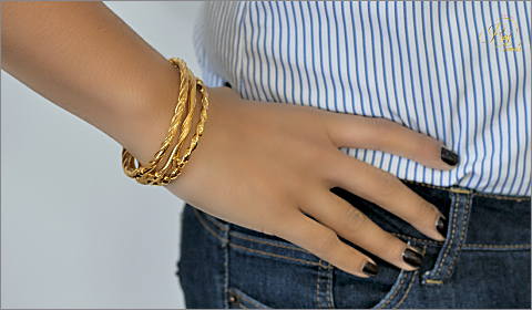 banker stripes paired with wavy gold bangles accessories