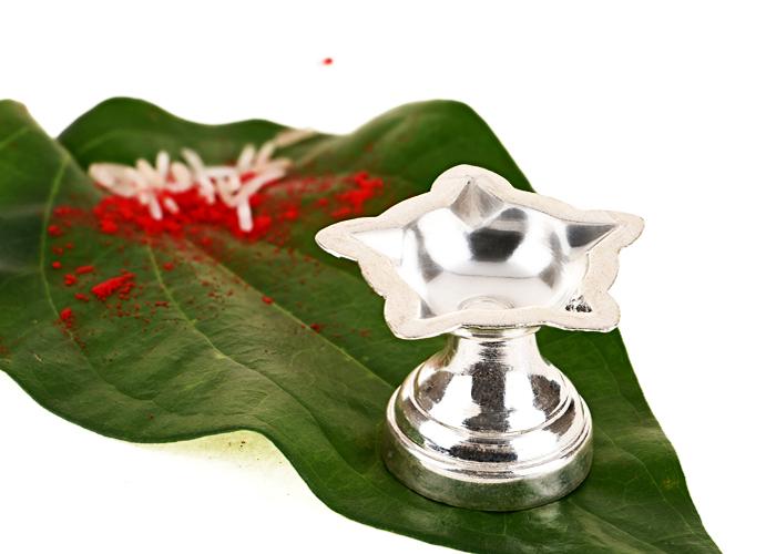 Silver diyas and pooja thalis
